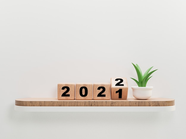 Lançando bloco de cubos de madeira para mudança de 2021 a 2022 na prateleira de madeira e planta para preparação feliz natal e feliz ano novo, renderização em 3d