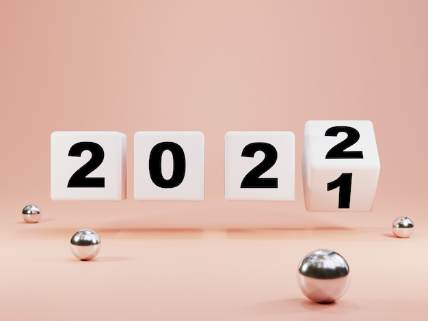 Lançando o bloco de cubo branco para a mudança de 2021 a 2022 em um fundo de cor rosa pastel com bolas metálicas, feliz natal e feliz ano novo do conceito de renderização 3d.