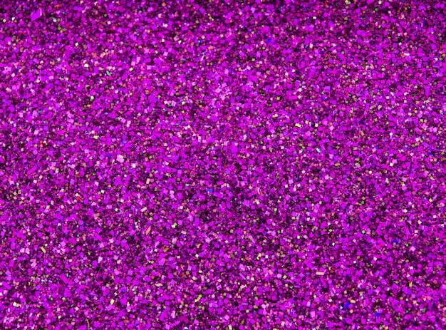 Lantejoula de glitter de fundo. fundo rosa quente.