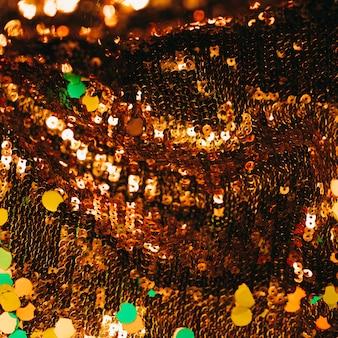 Lantejoulas brilhantes marrons com confete