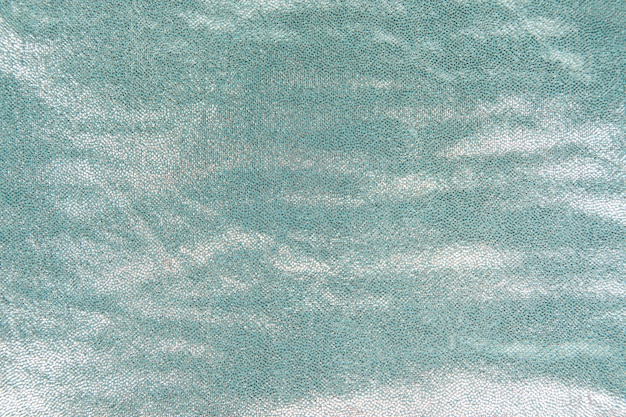 Lantejoulas brilhantes turquesas texturizadas em fundo