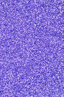 Lantejoulas decorativas violetas. imagem com luzes brilhantes bokeh de pequenos elementos