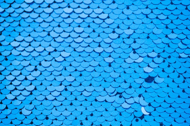 Lantejoulas reflexivas azuis do fundo abstrato do quadro completo