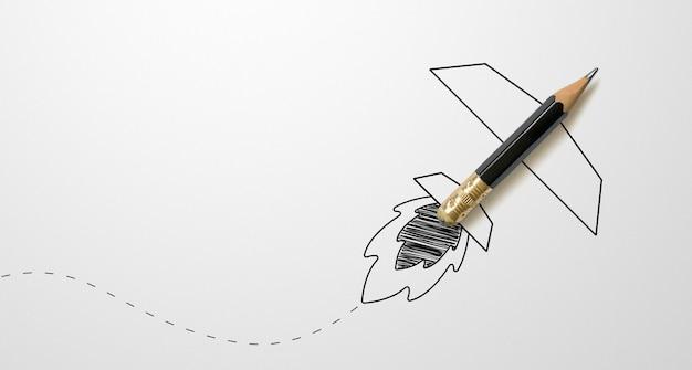 Lápis de cor preta com foguete de contorno em fundo de papel branco. conceito de ideias de inspiração de criatividade