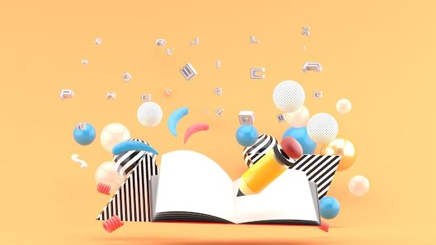 Lápis e cadernos na fonte e bolas coloridas no espaço laranja