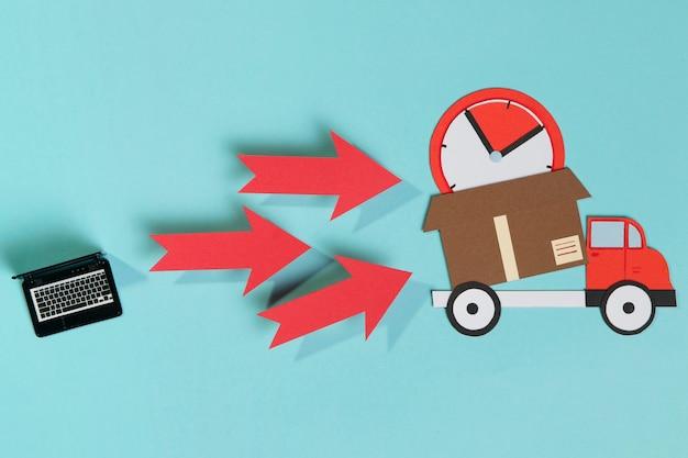 Laptop e caminhão de entrega com caixa