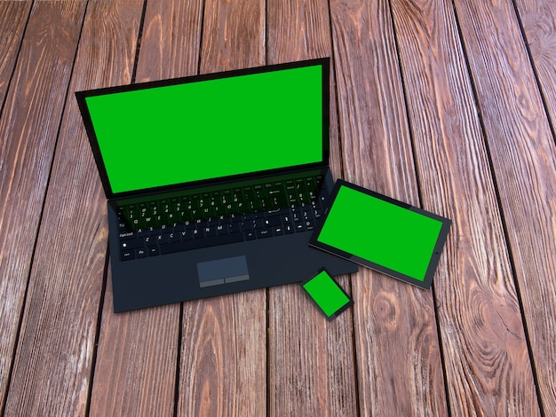Laptop, tablet e smartphone na mesa de madeira