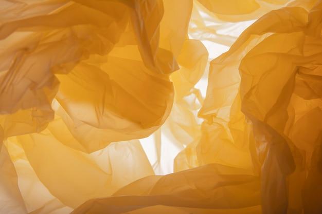Laranja . textura de saco de plástico laranja.