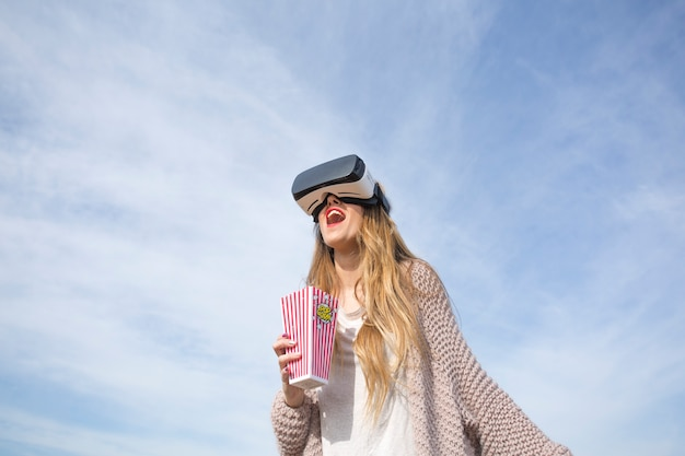 Laughing woman in vr goggles