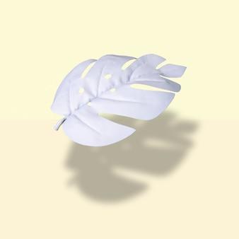 Layout criativo com folhas de monstera brancas flutuando em um fundo amarelo pastel minimal tropical