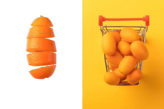 Layout criativo feito de cumquat ou kumquat em um carrinho de compras em fundo amarelo