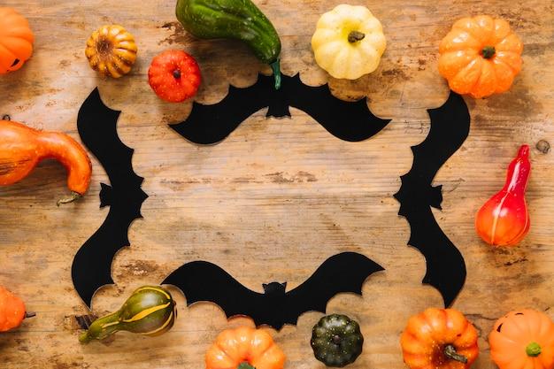 Legumes coloridos e morcegos de halloween
