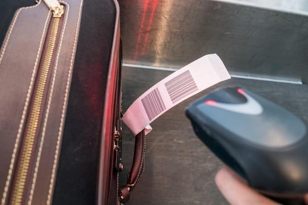 Leitor de código de barras com scanner a laser para carregar malas de bagagem no aeroporto