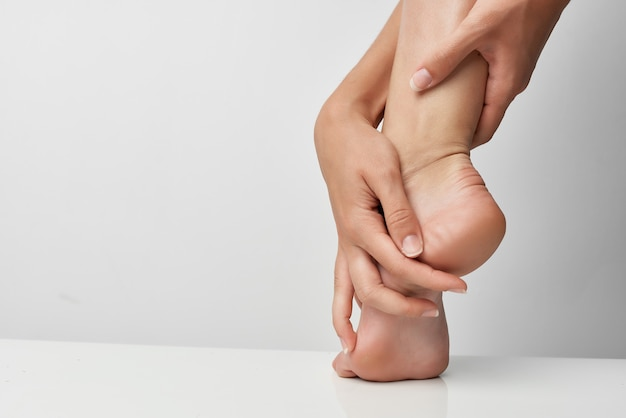 Lesão nos pés massagem problemas de saúde remédio closeup