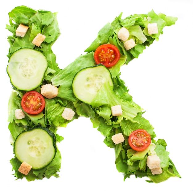 Letra k, com croutons crocantes