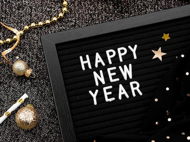 Letras de ano novo com glitter e bolas