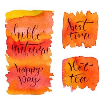 Letras de caligrafia em aquarela. olá outono, dia feliz, melhor horário e chá quente