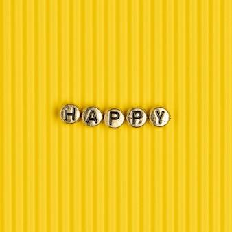 Letras de contas douradas da palavra feliz
