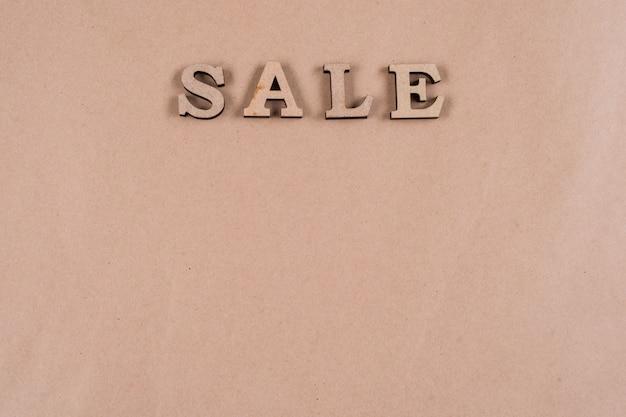 Letras de madeira abstratas da venda da palavra