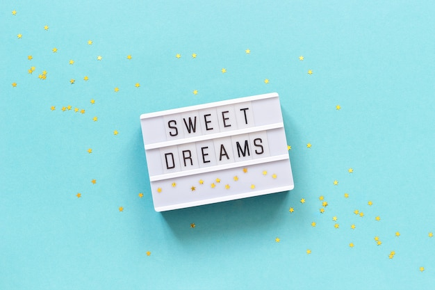 Lightbox text sonhos doces e estrela de ouro. concept good night greeting card vista superior plano criativo