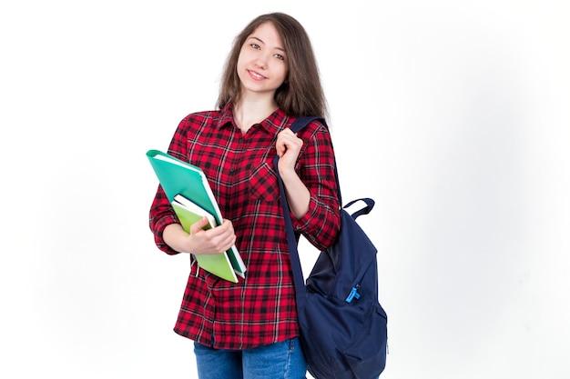 Linda garota colegial, estudante com livros didáticos e mochila