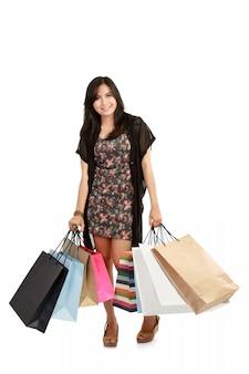 Linda mulher asiática com sacos de compras Foto Premium