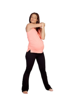Linda mulher grávida fazendo alongamento