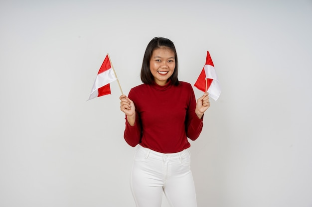Linda mulher indonésia feliz em comemorar o dia da independência da indonésia