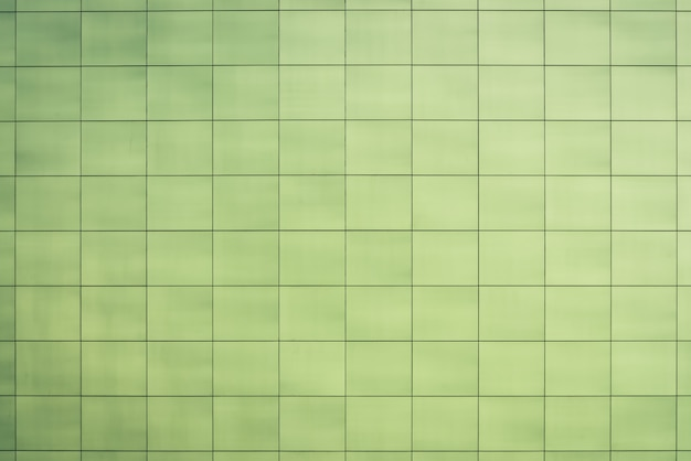 Lindo banheiro esverdeado, cozinha, banheiro - azulejos quadrados suaves close-up. luz - textura verde da parede, piso, teto estreitamente com copyspace. fácil verde elegante enfrentando azulejo da parede do edifício.