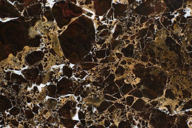 Lindo mármore de pedra marrom com veios brancos chamado emperador gold.