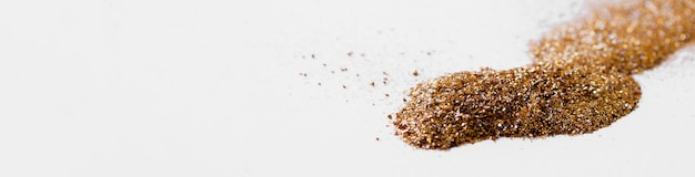 Linha curvilínea de glitter dourado