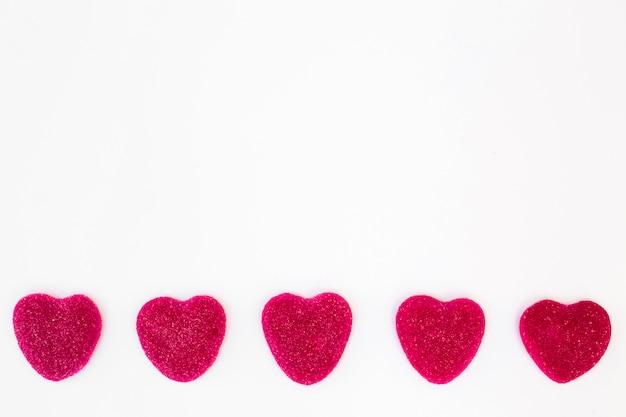 Linha de doces doces em forma de coração