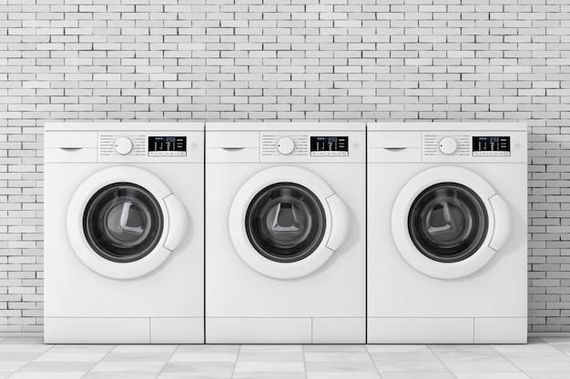 Linha de máquinas de lavar modernas na frente da parede de tijolos. renderização 3d