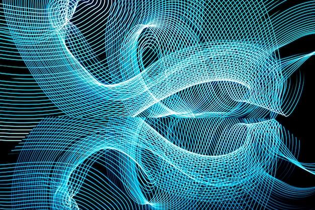 Linha de néon brilhante projetada fundo, filmado com longa exposição, azul