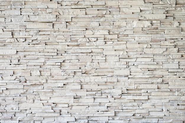 Linha de pedra fundo de tijolo