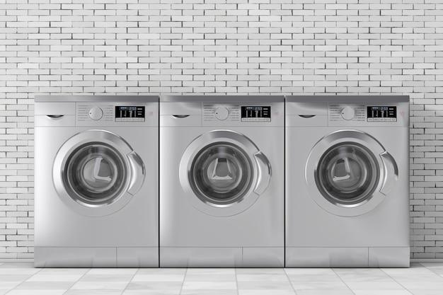 Linha de prata modernas máquinas de lavar na frente da parede de tijolos. renderização 3d
