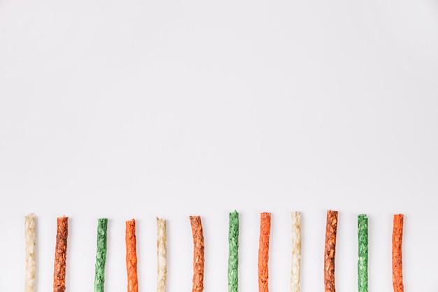 Linha de varas de mascar