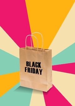 Liquidação de sexta-feira negra com saco de papel em quarto colorido