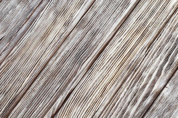 Listras cinza e brancas na superfície pintada de madeira