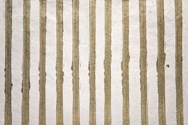 Listras de ouro na superfície branca