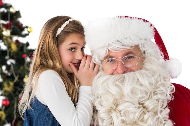 Little girl teling santa claus um segredo
