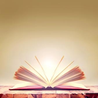 Livro aberto na mesa de madeira.