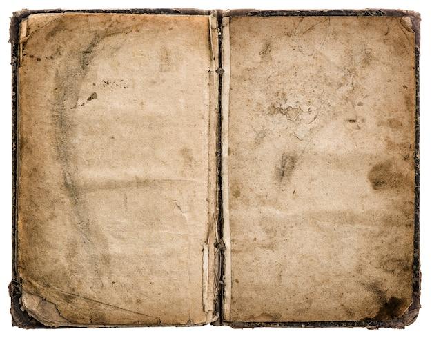 Livro antigo aberto isolado no fundo branco. textura de papel suja e gasta