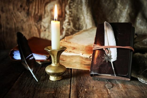 Livro caneta vela romance