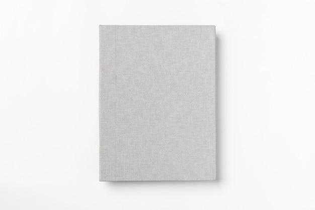 Livro de capa dura cinza, isolado no fundo branco. vista do topo