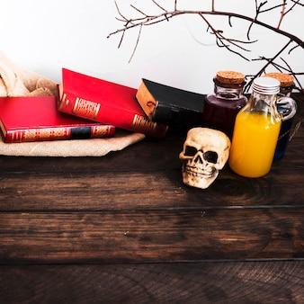 Livros e poções na mesa de madeira