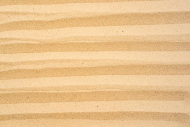 Lixe o fundo da praia e texture o teste padrão com espaço.