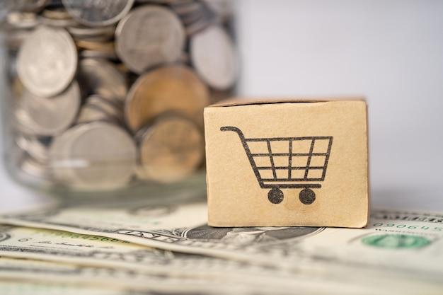 Logotipo do carrinho de compras na caixa com notas de dólar americano.