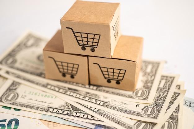 Logotipo do carrinho de compras na caixa com notas de dólar americano