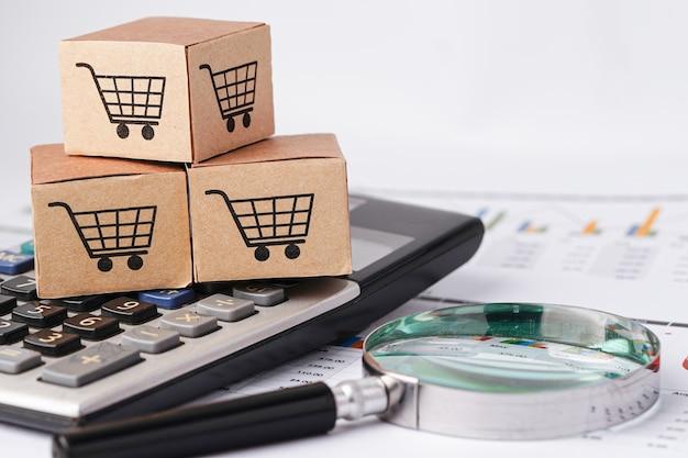 Logotipo do carrinho de compras na caixa e calculadora com gráfico.